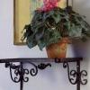 №047 Настенная кованая подставка под цветы